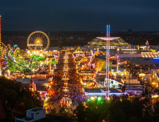 19427624 - view of the oktoberfest in munich at night.
